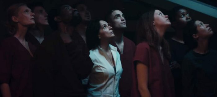 highlife-robertpattinson-group-staringup-700x313